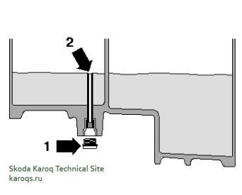 Трансмиссионное масло вытекает из переливной трубы - стрелка 2 - 0D9 (DSG)